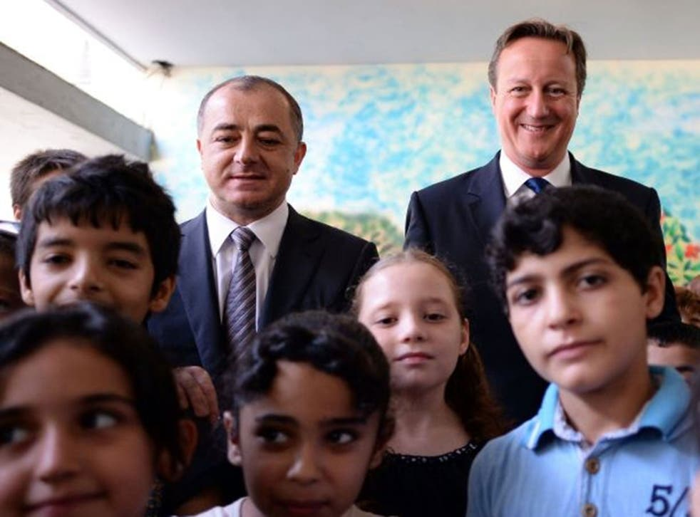 Lebanese Education Minister Elias Bou Saab stands beside Prime Minister David Cameron at the Sed El Boucrieh School in Beirut