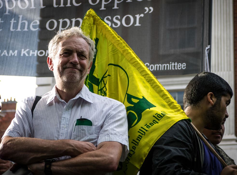 Samuel Hardy caught the moment a man carrying a Hezbollah flag walked behind Jeremy Corbyn at a protest in 2012