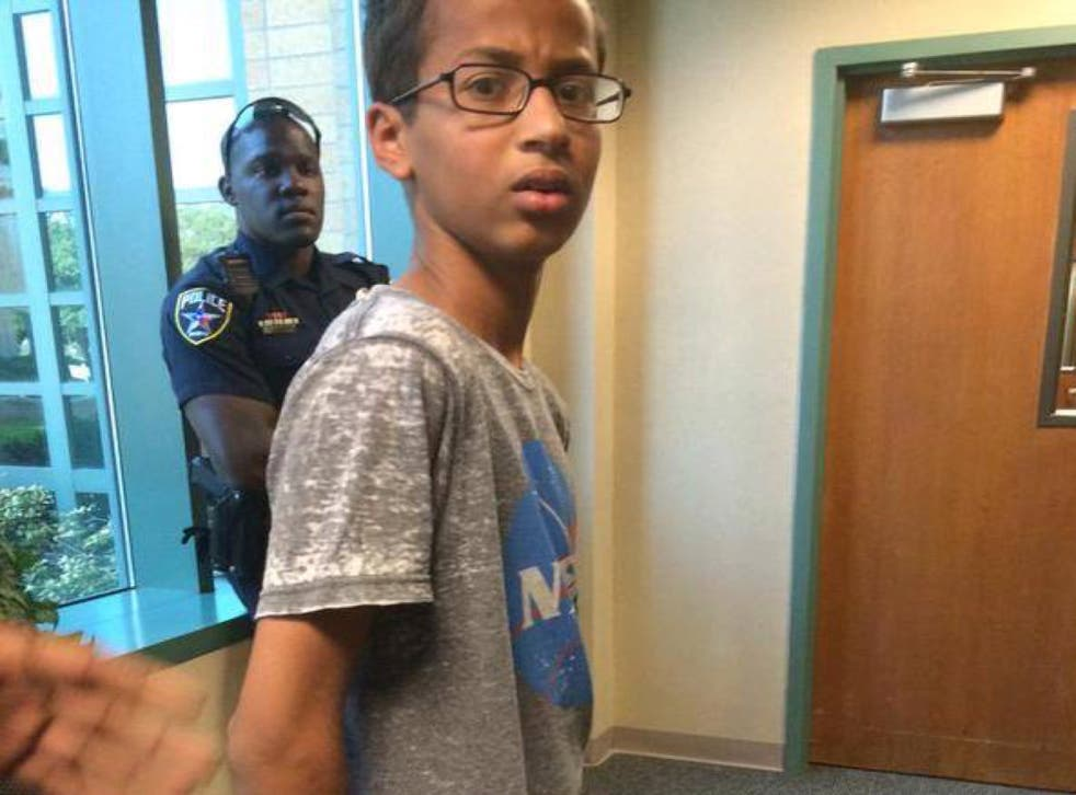 The teenager was led away in cuffs
