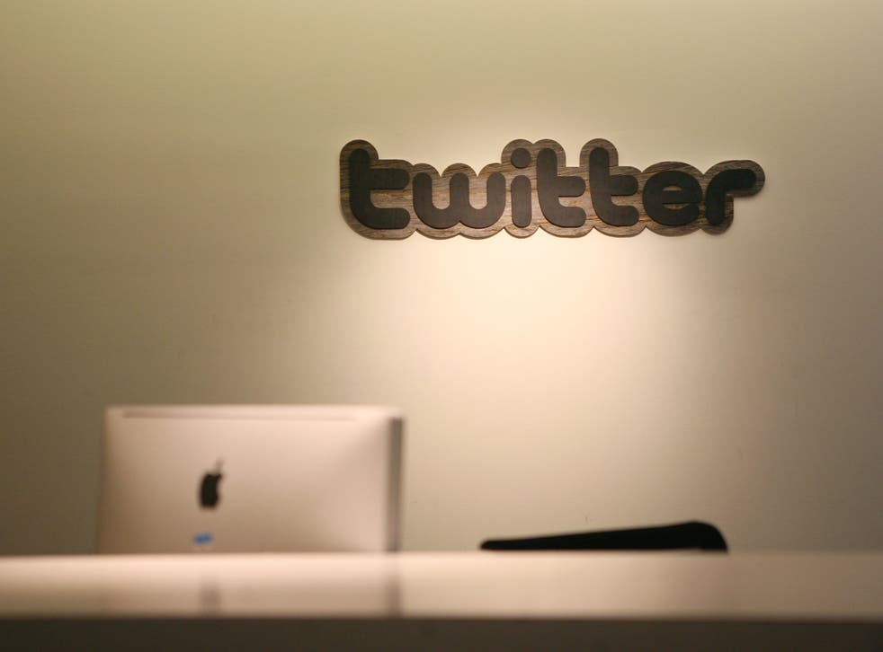 Twitter logo is displayed at the entrance of Twitter headquarters in San Francisco on March 11, 2011 in California