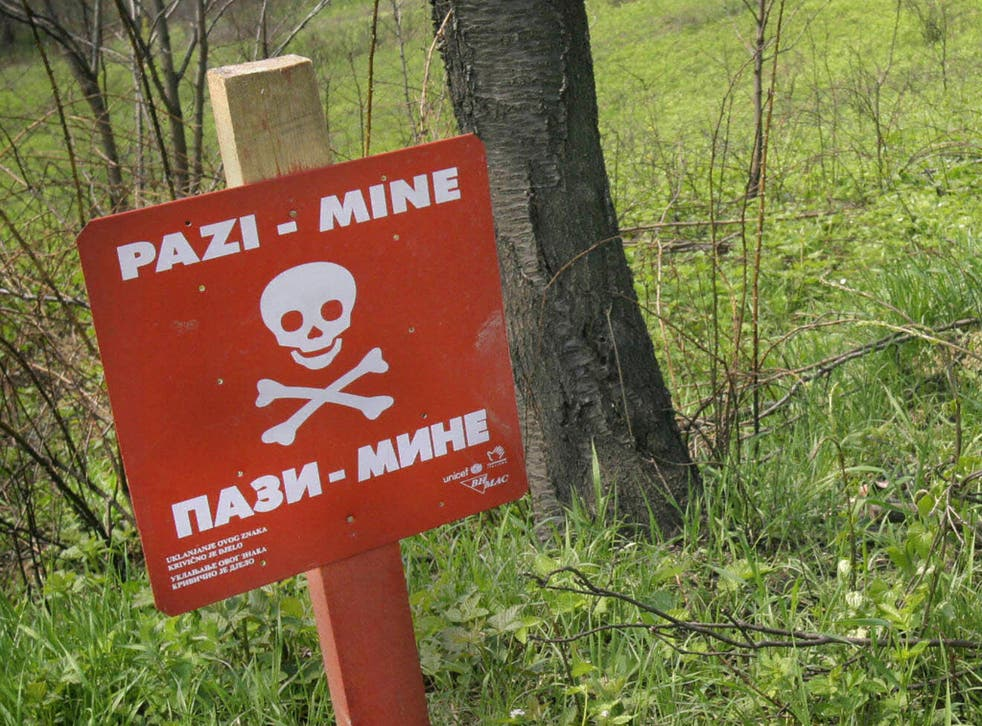 File: A warning sign in front of a minefield in the Bosnian town of Modrica, near the Croatian border