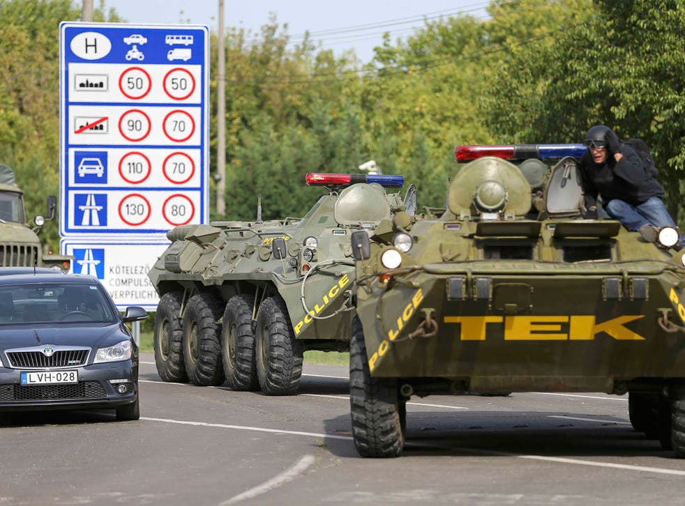 Soldiers and riot police have been deployed along Hungary's borders as it accuses its neighbours of 'human smuggling'