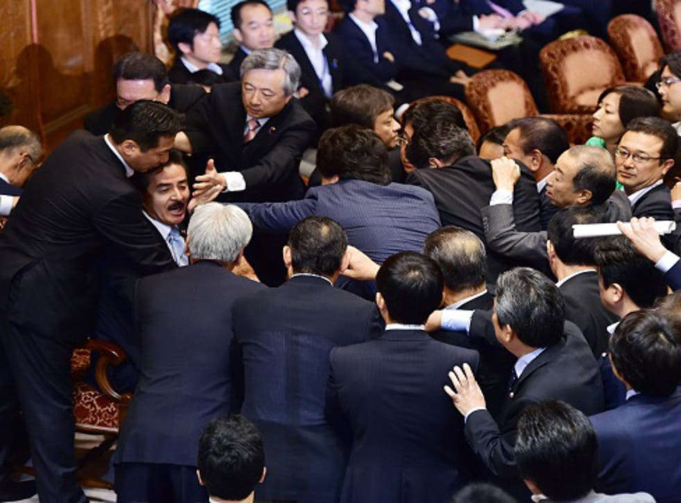 Japanese politicians fought over controversial proposals which critics say will lead to war