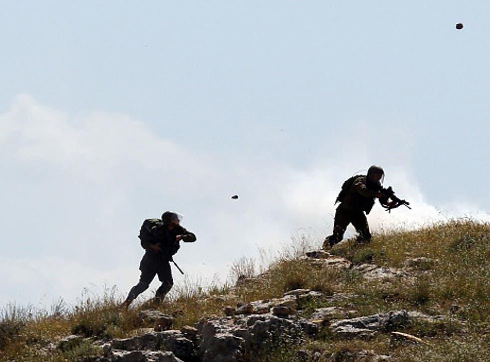 Israeli soldiers being pelleted with rocks