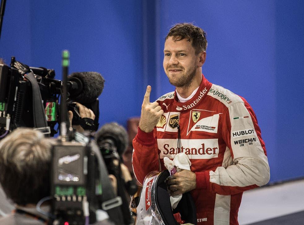 Sebastian Vettel celebrates taking pole in Singapore