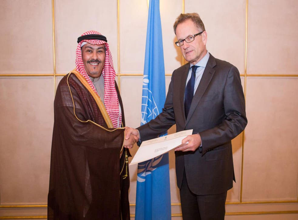 H.E. Mr. Faisal bin Hassan Trad, the Kingdom of Saudi Arabia(left), presents his credentials to Mr. Michael Møller(right), the Acting Director-General of the United Nations Office at Geneva. January 7th, 2014.