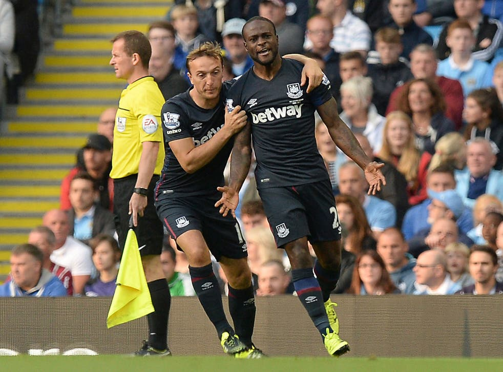 Victor Moses, right, celebrates scoring the opener with West Ham team-mate Mark Noble