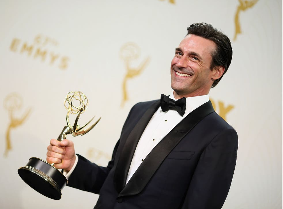 Jon Hamm with his Emmy for best actor