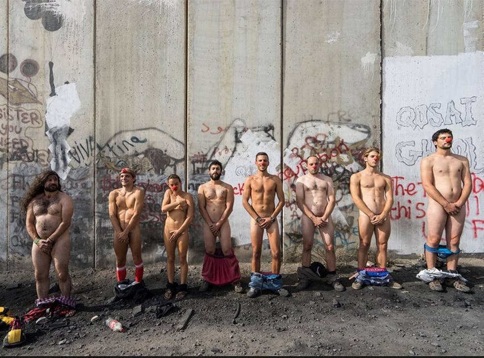 Members of Pallasos en Rebedia, which translates to Clowns in Rebellion, at the wall separating Israel with the West Bank