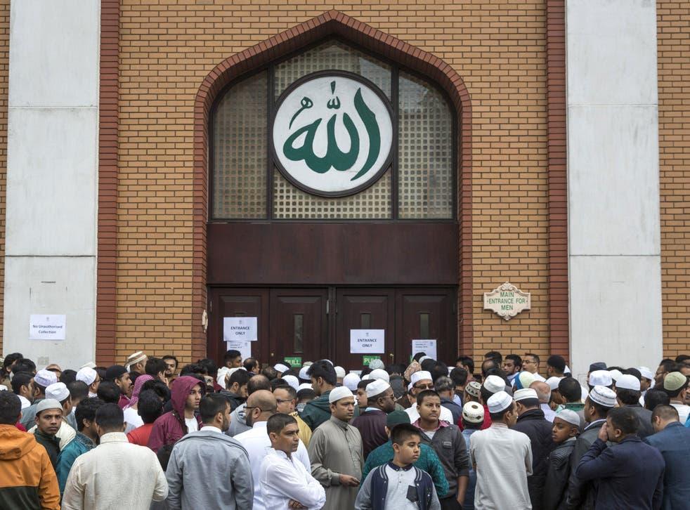 Men wait to enter the East London Mosque on Eid al-Adha 2014