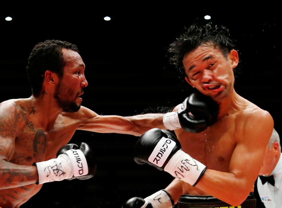 Japanese champion Shinsuke Yamanaka, right, gets a punch from Panama's challenger Anselmo Moreno in the eighth round of their WBC bantamweight boxing title match in Tokyo, Japan. Yamanaka defended his title by a 2-1 decision