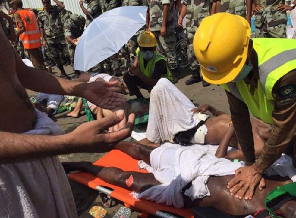 A medic tends to one of the more than 300 people injured in the stampede
