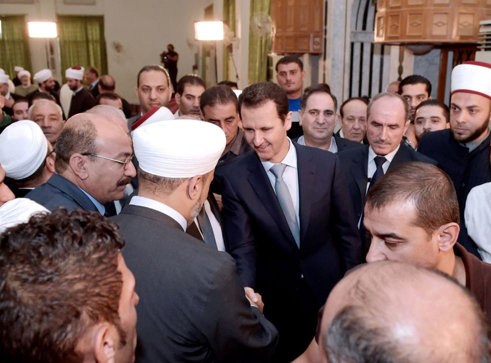 President Assad greets worshippers after the morning prayer to mark the Muslim holiday of Eid al-Adha at the Al-Adel mosque in Damascus, in one of his rare public appearances