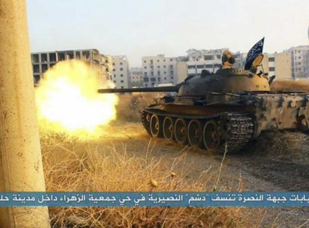 An al-Nusra Front tank fires during their clashes against the Syrian government forces, taken from Twitter account affiliated with the group
