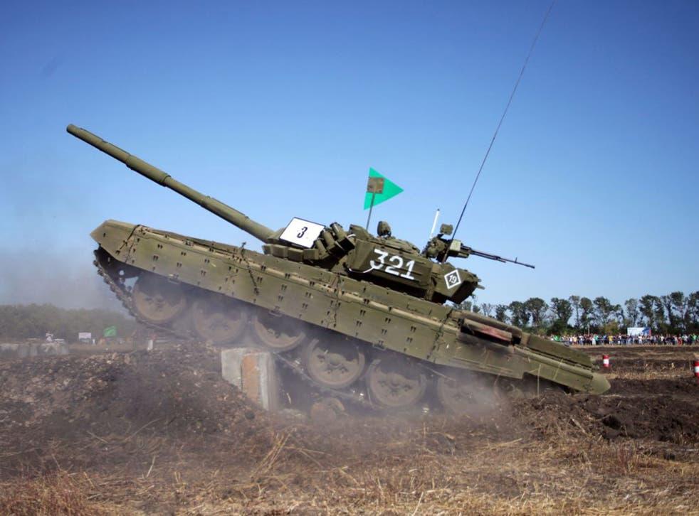 Pro-Russian separatists take part in tank war games in Torez, Donetsk