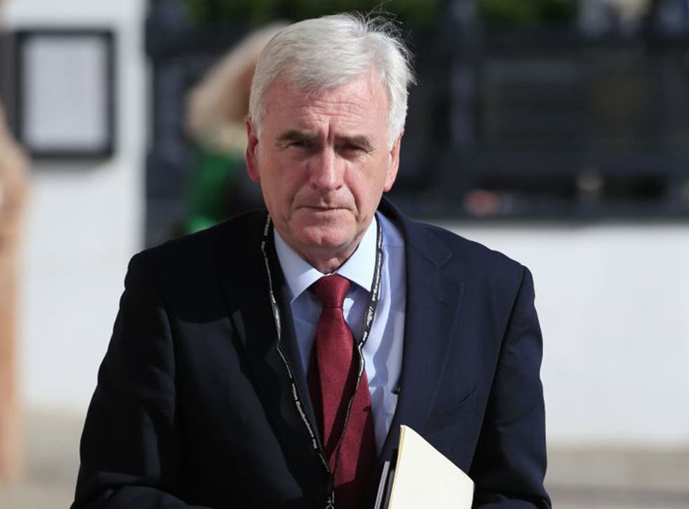 The Labour shadow chancellor knelt before the Queen at his induction to the Privy Council