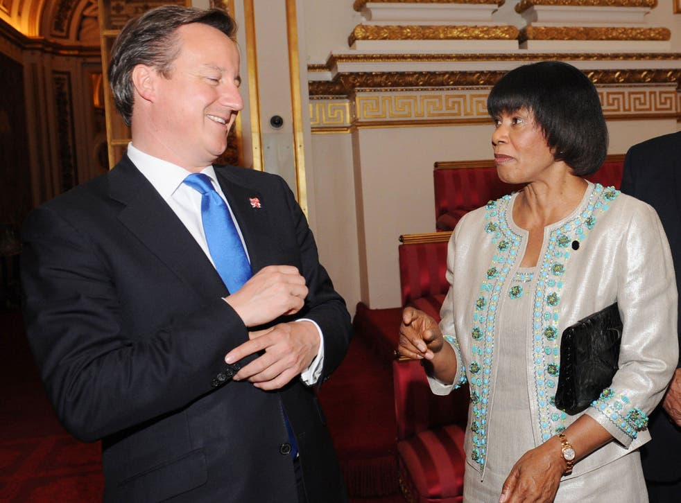 David Cameron (L) meets with Prime Minister of Jamaica Portia Simpson Miller at Buckingham Palace in 2012