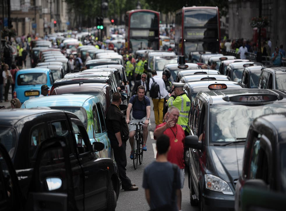 Cab drivers cause gridlock in central London during a 2014 anti-Uber protest