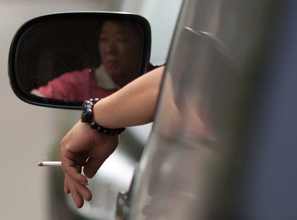 Motorists could be fined £50 if they are found smoking in a car when a child is present