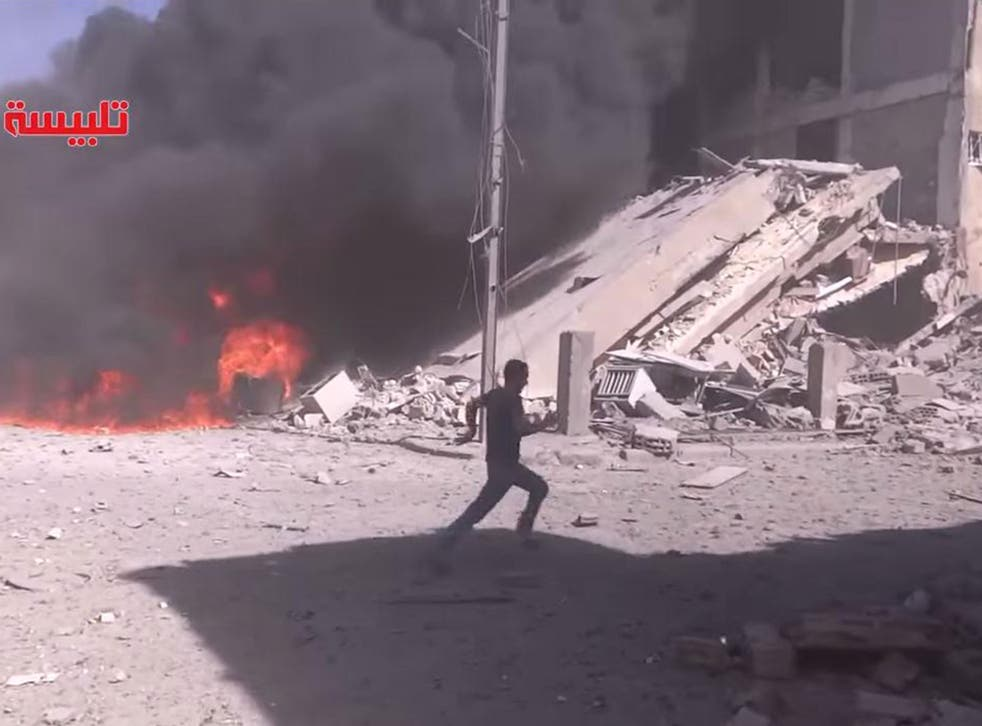 A screengrab of footage claiming to show the aftermath of air strikes by a Russian plane in Tabliseh, Syria, on 30 September 2015