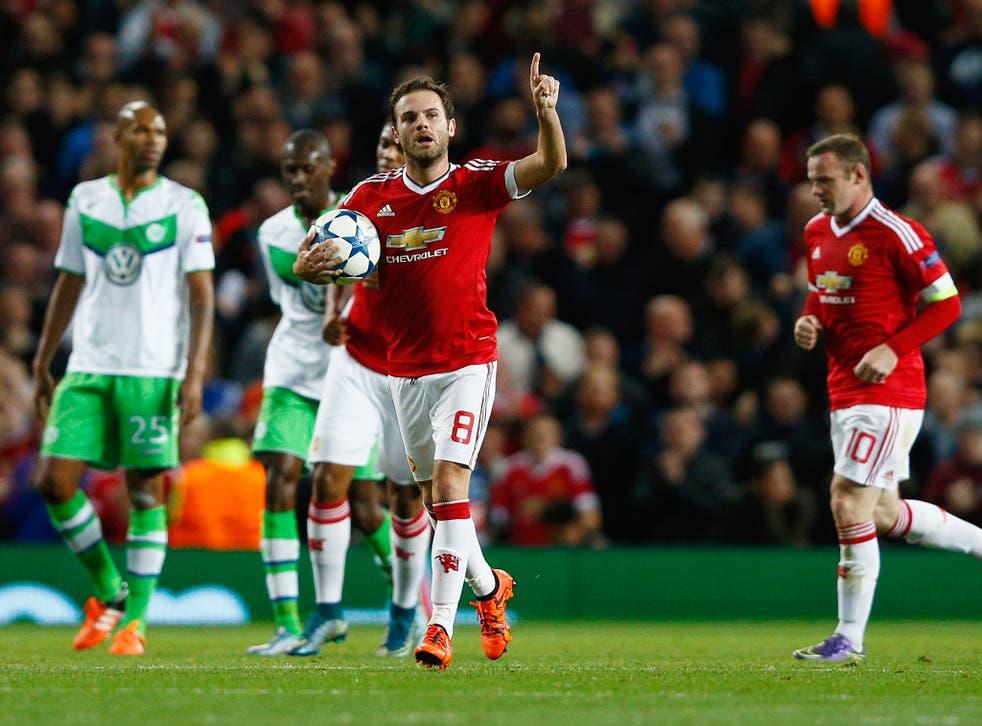 Juan Mata celebrates his penalty