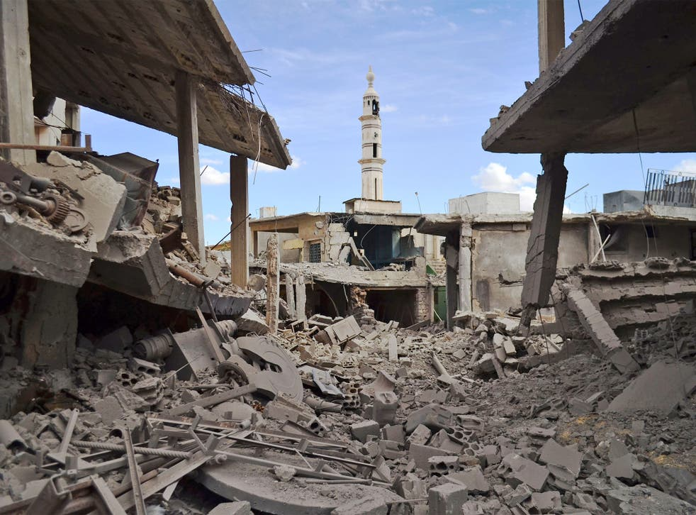 Damaged buildings the Syrian town of Talbiseh, Homs, following the air strikes
