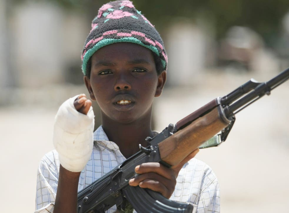 A young fighter from the Al-Shabab militia shows his wounded hand which he suffered while battling Somali government forces in Mogadishu