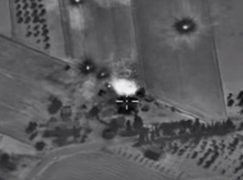The video claimed to show four air strikes on Isis positions overnight on 1 October