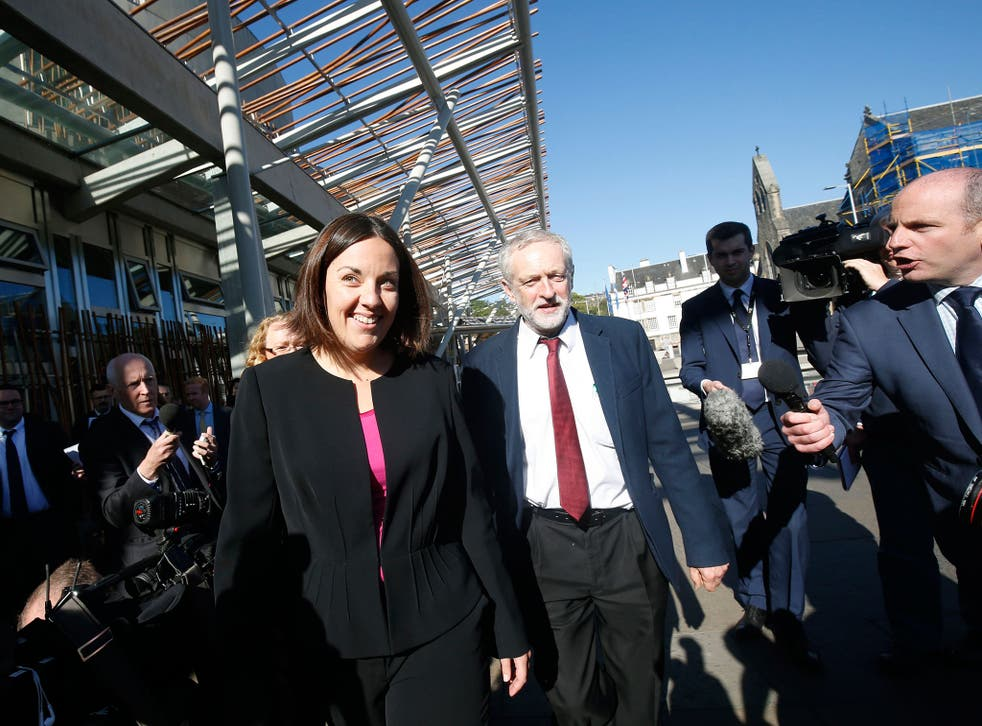 Jeremy Corbyn and Kezia Dugdale arriving at the Scottish Parliament building