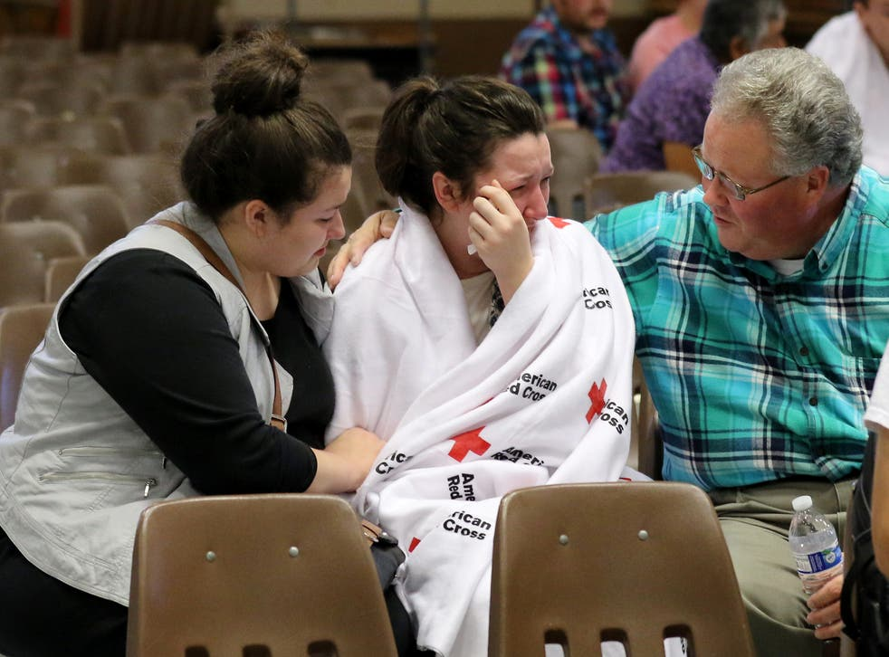 Hannah Miles, is reunited with her sister Hailey and father Gary after a shooting at Umpqua Community College.
