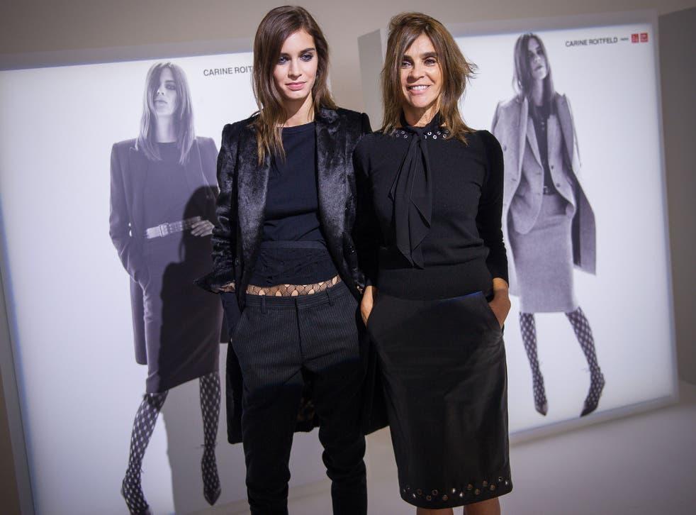 Carine Roitfeld (right) at a Uniqlo presentation for Paris Fashion Week