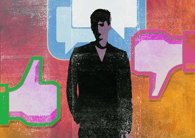 A man stands in front of speech bubbles between thumbs up and thumbs down