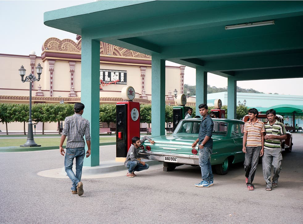 Both car and gas station are part of the film set