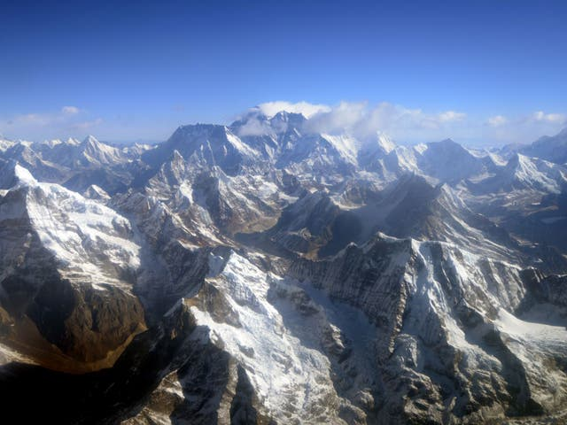 An aerial view of Mount Everest (C) and The Himalayan mountain range