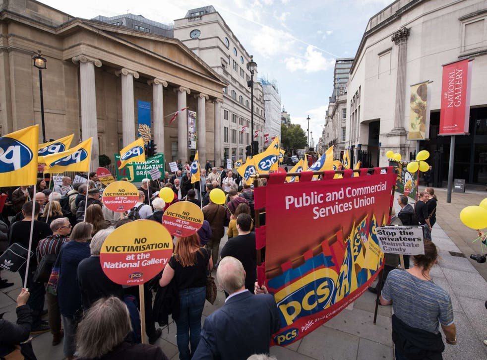 Demonstraters hold yellow balloons and home-made sunflowers outside the National Gallery in London on September 24, 2015, during a protest to mark 100 days since the beginning of strike action