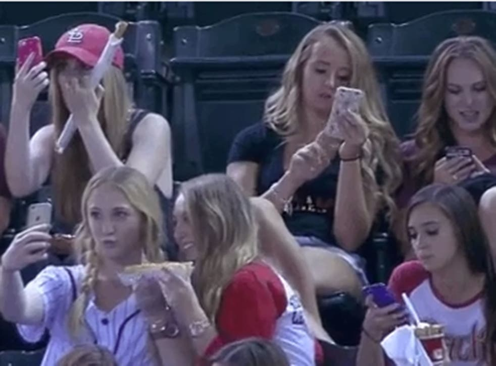 The girls were mocked for taking selfies at a baseball game