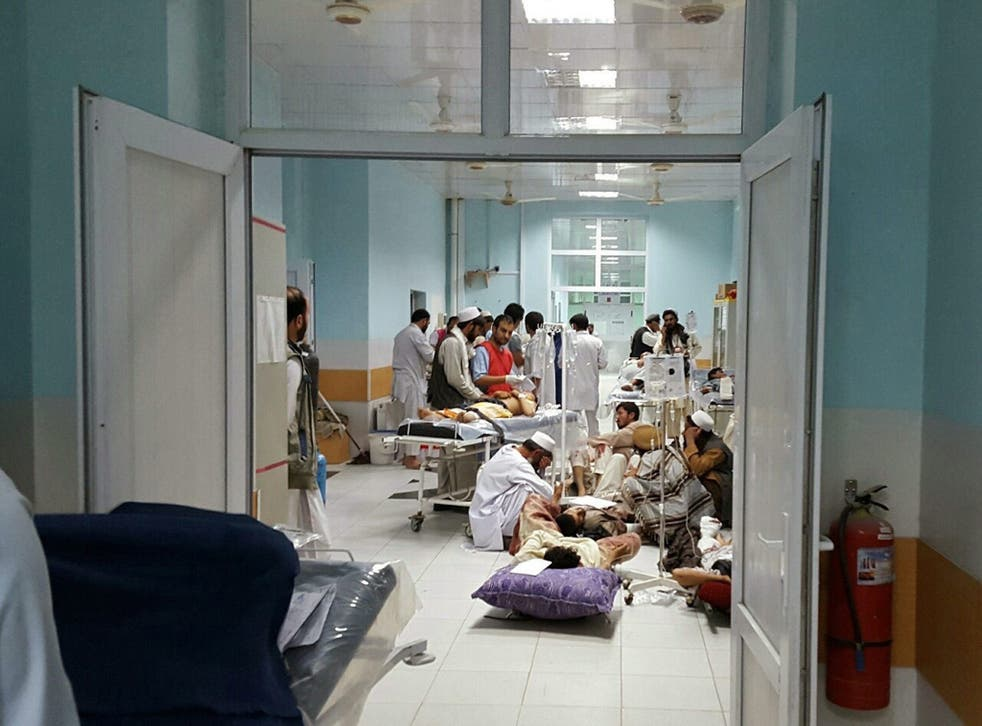 Doctors from Médecins Sans Frontières treat civilians injured in airstrikes against Taliban militants in Kunduz