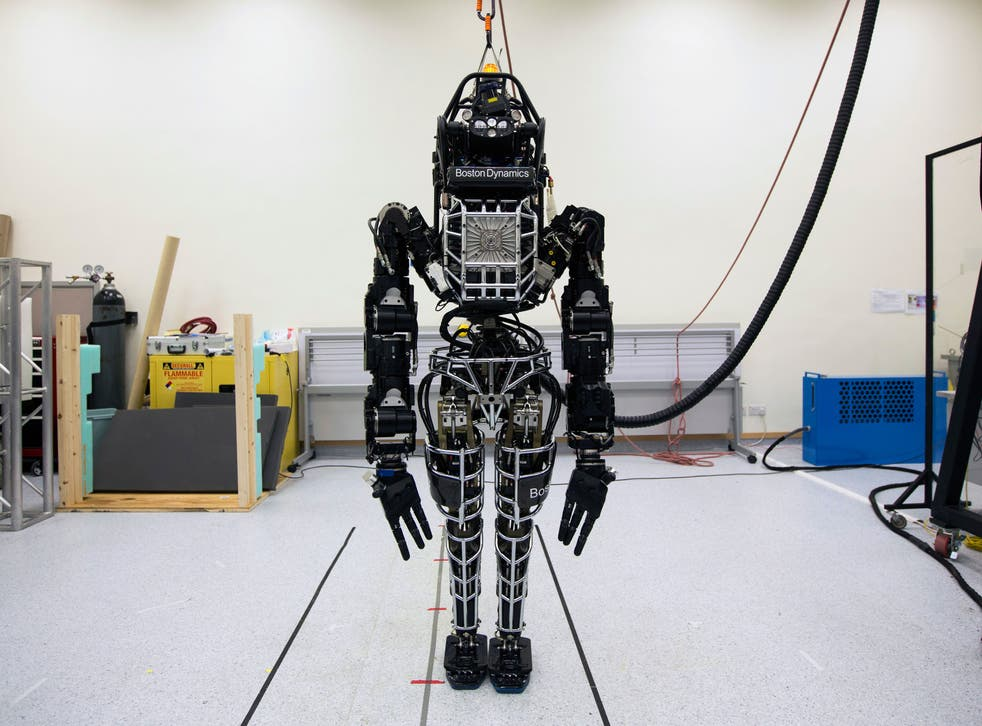 """Bipedal humanoid robot """"Atlas"""", primarily developed by the American robotics company Boston Dynamics, is presented to the media during a news conference at the University of Hong Kong October 17, 2013"""