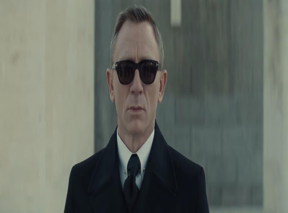 Moody looking Craig donning sunglasses