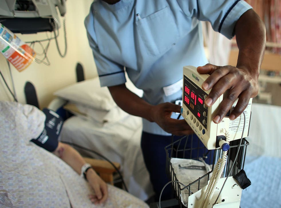 A nurse tends to recovering patients on a general ward at The Queen Elizabeth Hospital on March 16, 2010 in Birmingham, England