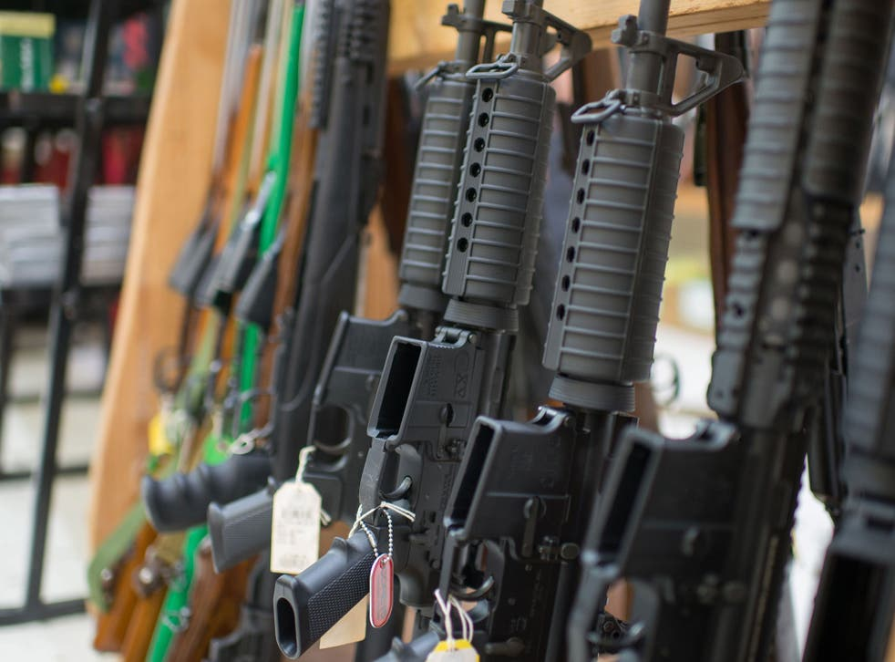 Guns are on display at Roseburg Gun Shop in Roseburg, Oregon