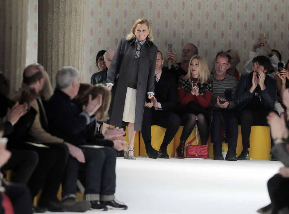 Miuccia Prada takes the applause after the presentation of Miu Miu's ready-to-wear fall-winter 2015-2016 collection at Paris fashion week