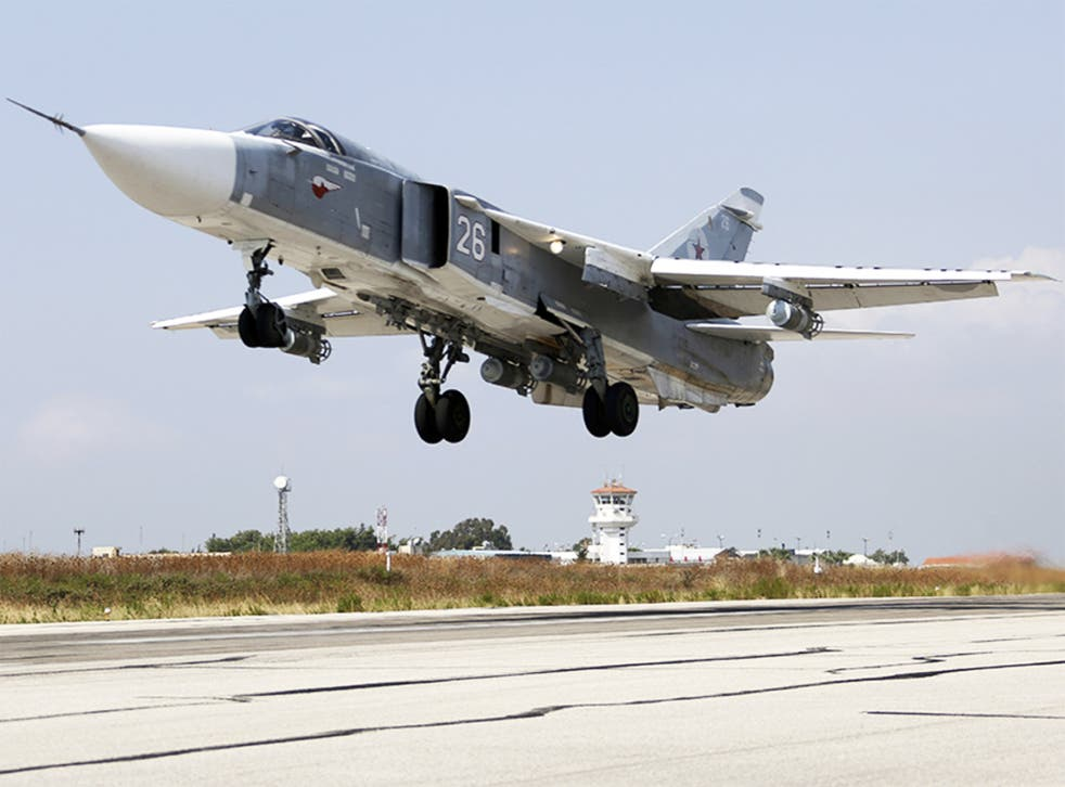 As Russian air stikes in Syria intensify, a SU-24M jet fighter takes off from a Syrian airbase