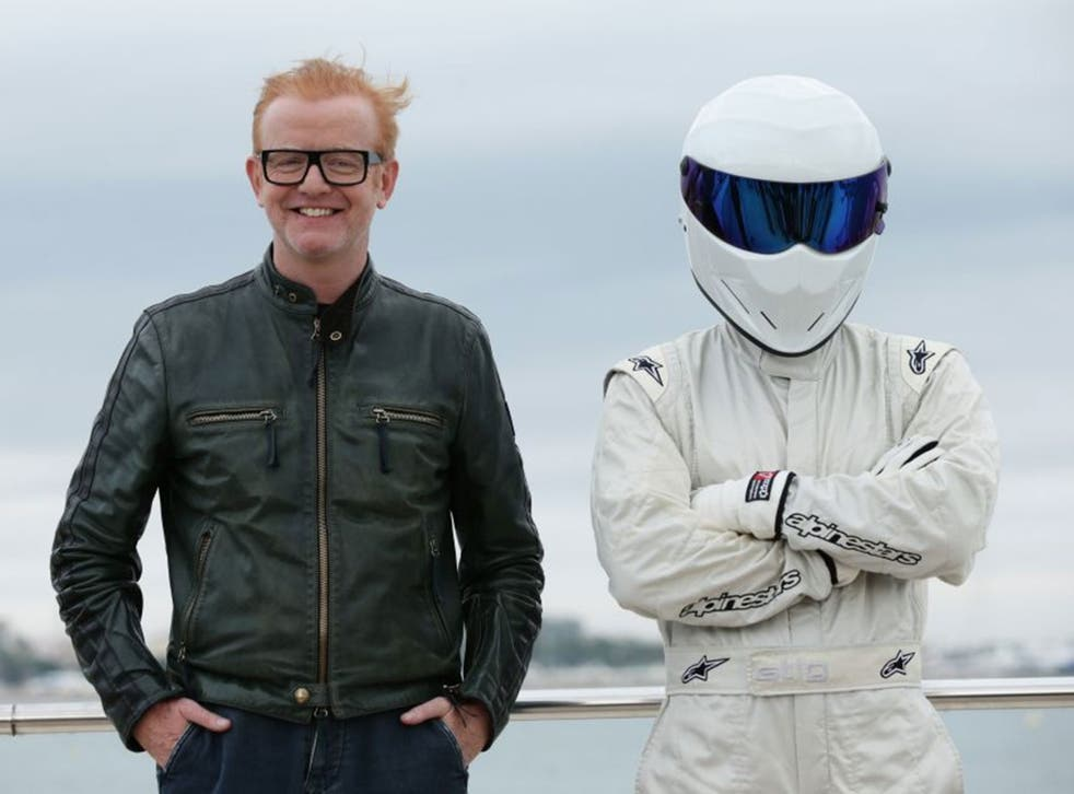 Chris Evans, the new presenter of BBC's Top Gear programme, and The Stig pose together