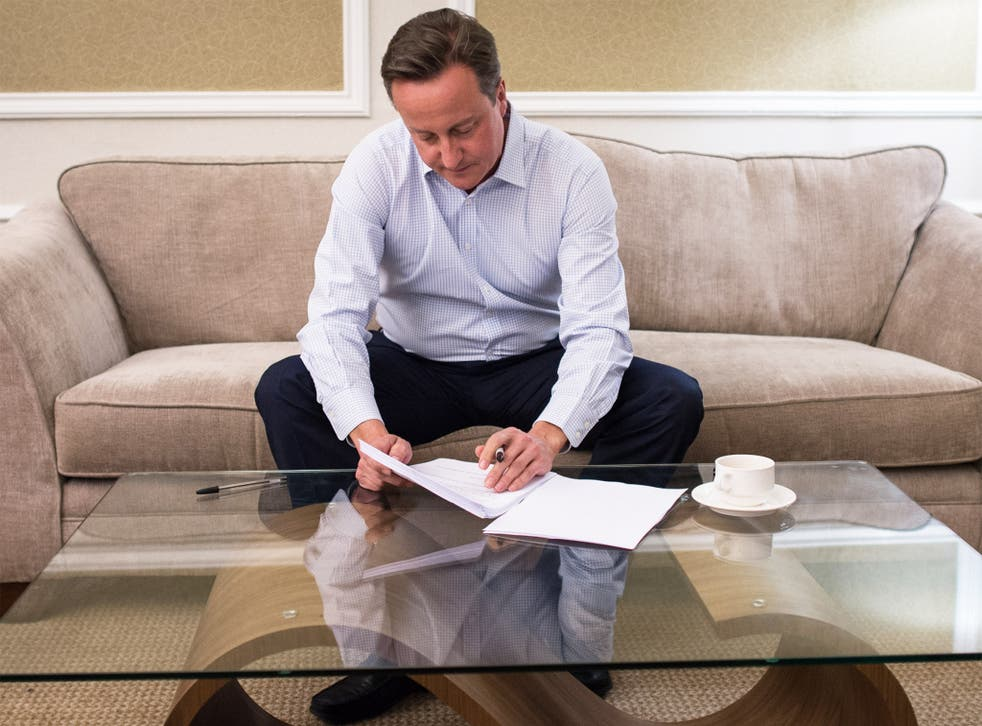 David Cameron prepares his conference speech in his Manchester hotel room last night