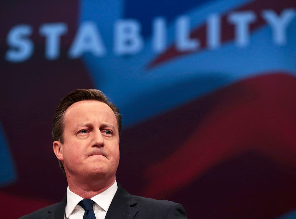 David Cameron reacts as he speaks at the annual Conservative Party Conference in Manchester