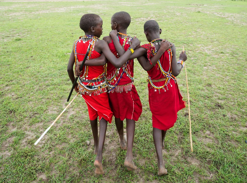 Kenyan Maasai school children in traditional costume. East African people owe up to a quarter of their DNA to ancient Asians and Europeans who migrated into the region