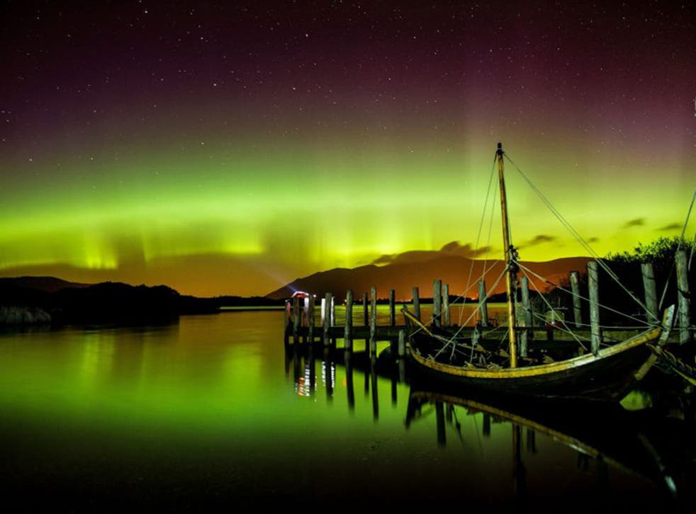 The Northern Lights, or Aurora Borealis, shine over Derwentwater, near Keswick, in the Lake District on Wednesday night