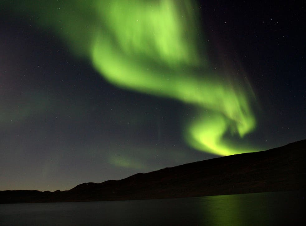 The Northern Lights, visible over Greenland