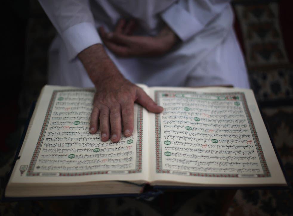 A man reads the Quran
